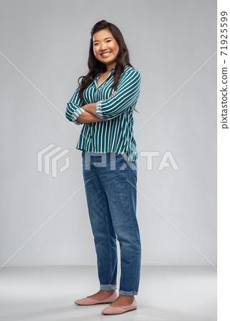 happy smiling asian woman with crossed arms 71925599