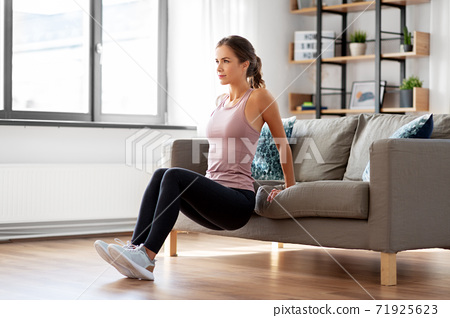 young woman exercising at home 71925623