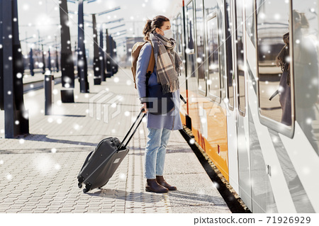 woman in protective face mask at railway station 71926929