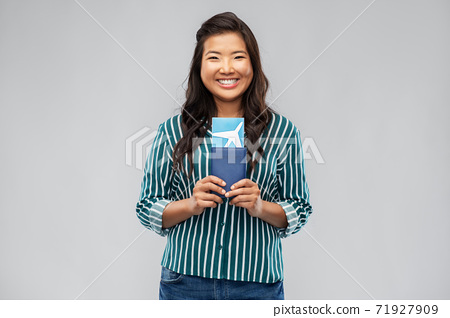 happy asian woman with air ticket and passport 71927909