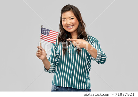 happy asian woman with flag of america 71927921