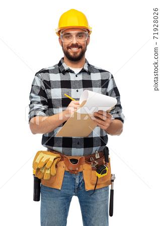 male worker or builder in helmet with clipboard 71928026