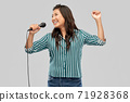 happy asian woman with microphone singing 71928368