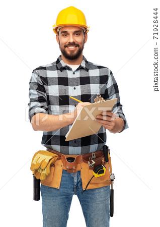 male worker or builder in helmet with clipboard 71928444