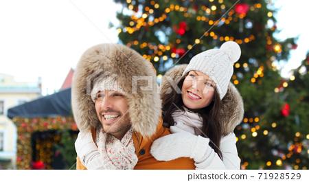 happy couple over christmas market background 71928529
