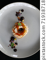 Chocolate dessert cake with berry sauce and almond with decorated 71938718