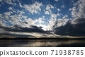 Clouds flowing over the river 71938785