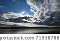 Clouds flowing over the river 71938788