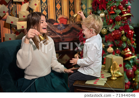 A Boy with Cochlear Implants play with Christmas Bell 71944046