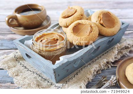 Homemade nut butter cookies and coffee 71949024