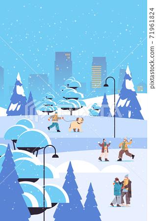 people in masks having winter fun men women spending time in park outdoors activities coronavirus quarantine 71961824