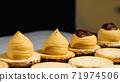 Making caramel macarons, close-up. 71974506