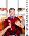 Junk food. Diverse fast food. The guy on the couch. In front of a man hands with sushi, pizza and burger. 71976434