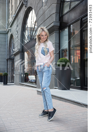 Young attractive woman dressed in pants 71993493