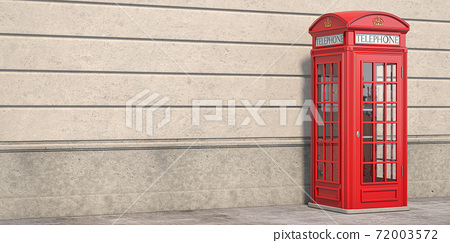 Red phone booth on brick wall background. London, british and english symbol. Space for text. 72003572