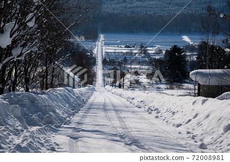 Winter rural road in Hokkaido 72008981