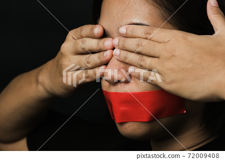 Asian woman blindfold wrapping mouth with red adhesive tape 72009408