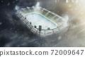 Hockey arena. Open hockey stadium in winter. Snowfall in the evening. Full spectator stadium. Hockey fans.Stadium top view.3d rendering 72009647