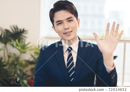 Head shot portrait confident young businessman  looking at camera and talking . business video conference concept 72014652