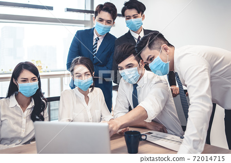 Busines people wearing face mask and  Business meeting in modern office while pandemic of virus 72014715