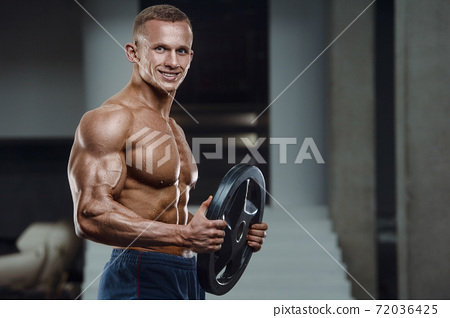 Caucasian man pumping up muscles. fitness training 72036425