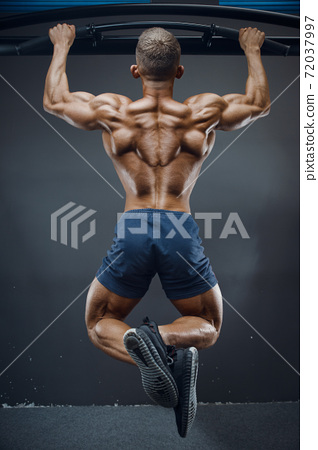 man pumping up muscle doing pull-ups exercises 72037997