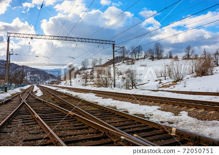 railway station in mountains. frosty winter landscape. transportation scenery 72050751