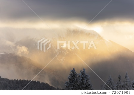 Majestic High mountains with winter snow 72071905