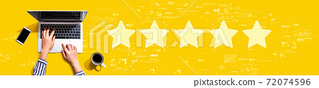 Rating star concept with person using laptop 72074596