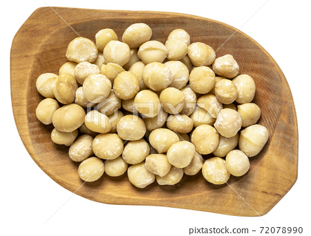 macadamia nuts in isolated bowl 72078990
