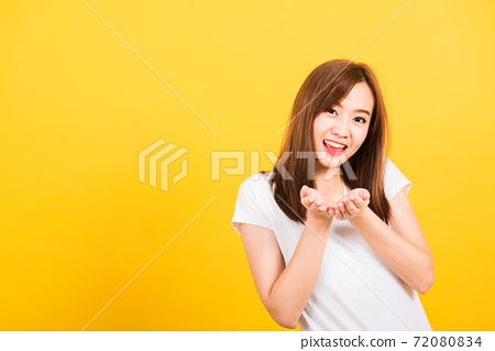 woman teen standing wear t-shirt blowing kiss air something on hands 72080834