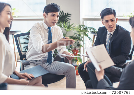 Corporate business team and manager discussing in office 72087765