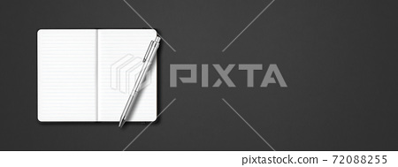 Black open lined notebook with a pen isolated on dark background. Horizontal banner 72088255