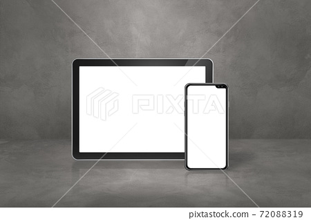 Mobile phone and digital tablet pc on concrete office scene 72088319