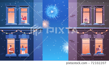 people in santa hats mix race neighbors standing in window frames looking at fireworks in sky new year christmas holidays 72102207