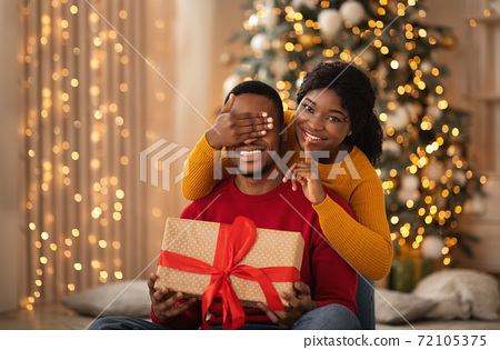 Surprise for loved one and gifts on Christmas eve 72105375