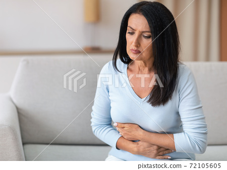 Mature Woman Suffering From Stomachache, Touching Belly 72105605
