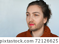 Portrait of young transgender woman. Girl with stubble (beard) 72126625