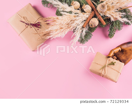 Minimal Xmas flat lay with presents on pink 72129334