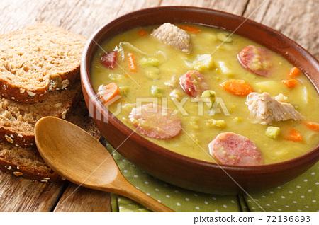 Classic Dutch pea soup erwtensoep, snert closeup in the plate. horizontal 72136893