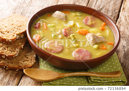 Snert  another name for erwtensoep, is a popular dish in Holland, and will often be quoted as the Dutch soup closeup on the table. horizontal 72136894