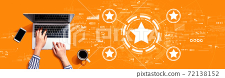 Rating star concept with person using laptop 72138152