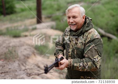 Happy Hunter Walks with Shotgun Lifestyle Concept. 72138930