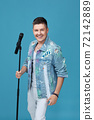 handsome singing man in denim with microphone 72142889