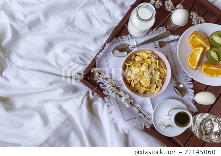 Romantic Breakfast in bed with spring flowers. Flat lay, copy space 72145060