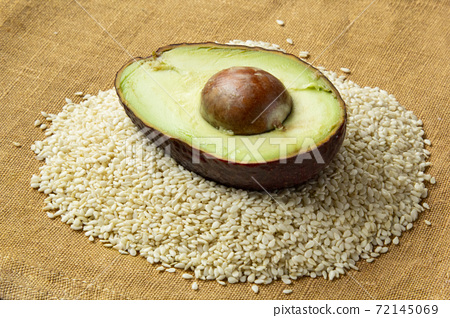 Close-up of Fresh cutted avocado with sesame seeds 72145069