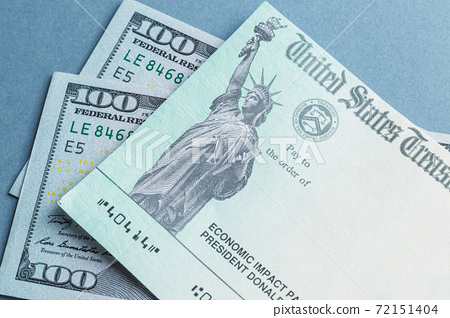 A US stimulus check on with some one-hundred-dollar bills 72151404