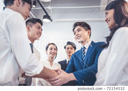 Happy businessmen handshaking after meeting 72154532