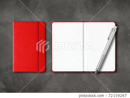 Red closed and open lined notebooks with a pen on dark concrete background 72159267