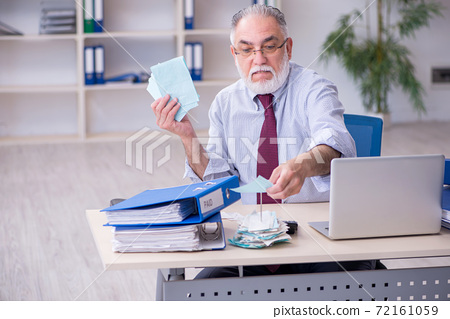 Old male accountant in budget planning concept in the office 72161059